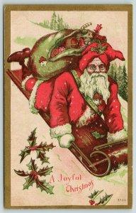 Christmas~Santa Rides Downhill on Toboggan~Toy Sack Back~Red Green~Gold Leaf