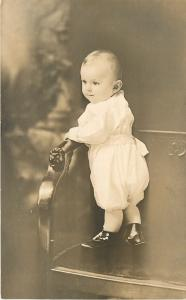 Baby Girl Standing In a Pew~SHARP! Real Photo Postcard c1920