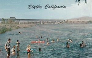 BLYTHE , California , 1950-60s ;  People playing in the water