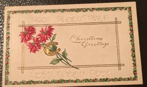Vintage 1913 embossed Christmas greeting card with cancelled stamp