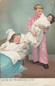 JOYS OF MARRIED LIFE, 1901-07; Child couple with doll, TUCK