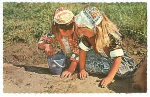 Netherlands, Marken, Dutch girls with traditional cloths
