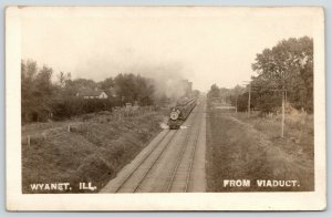 Wyanet Illinois~From Viaduct~Steam Train Leaves Grain Elevators Behind~1910 RPPC