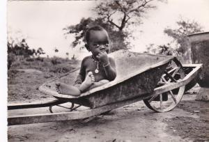 RP: Africa , 30-50s; Black Toddler in wheel barrel