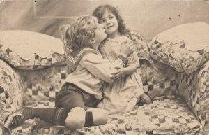 TUCK PLAYMATES # 4889; Children posing on loveseat