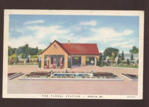 SEDALIA MISSOURI THE FLORAL STATION GAS STATION VINTAGE ADVERTISING POSTCARD