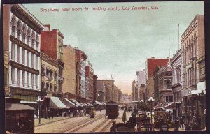 P1454 old unused postcard busy broadway. looking north los angeles calif