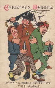 CHRISTMAS; 1900-10s;  Christmas Weights, Man carrying 2 drunks