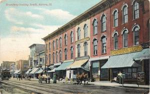 Postcard Aurora Illinois looking South Broadway 5 and 10 cent store horse 1909