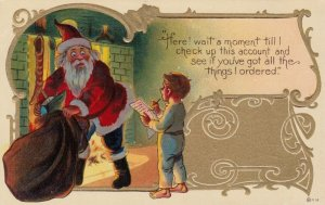 CHRISTMAS, 1900-10s ; Santa Claus & boy with a check list