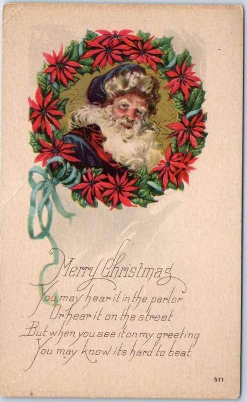 Vintage SANTA CLAUS Christmas Postcard BLUE SUIT Poinsettia Wreath c1910s