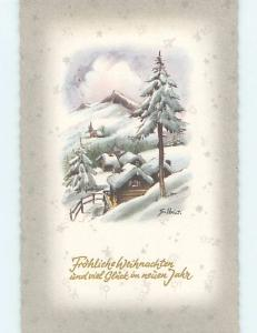 Pre-Chrome foreign signed MANY HOUSES COVERED IN SNOW IN THE MOUNTAINS HL8975