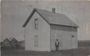 D55/ Lyons Nebraska Ne Real Photo RPPC Postcard 1909 Home Man Barn Construction