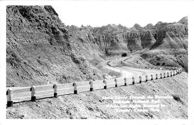 Badlands National Park SD~Vintage Car on Highway Thru Pinnacles~1940s RPPC