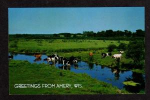 WI Greetings from AMERY WISCONSIN Postcard PC Cows Cattle Carte Postale