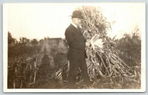 Real Photo Postcard~Businessman Examines Corn by Shuck Stack~Farm~c1912 RPPC
