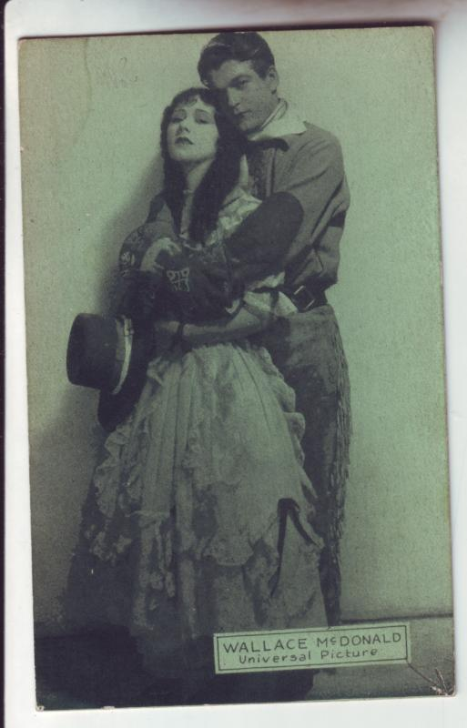 P1112 old card universal pictures wallace mc donald holding a woman