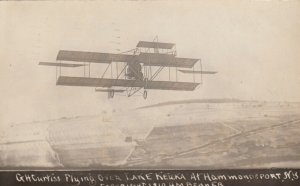 RP: HAMMONDSPORT , New York , 1910 ; G.H.Curtiss flying over Lake Keuka