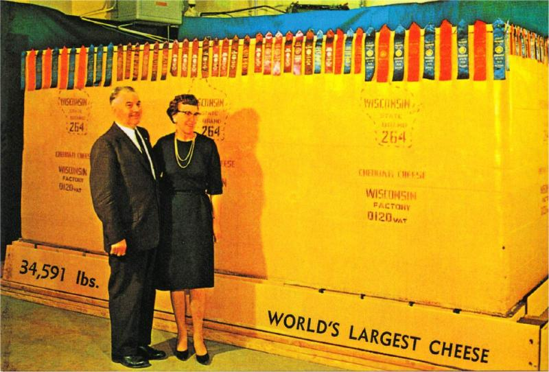 World's Largest Giant Wisconsin Cheese on Wooden Pallet Repro Postcard