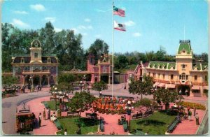 DISNEYLAND Postcard Bird's-Eye View of Town Square w/ Band / U.S. Flag / UPRR Ad