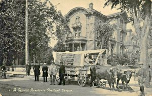 PORTLAND OREGON TYPICAL RESIDENCE-COVERED WAGON & OXEN-TRAIL EXPEDITION POSTCARD