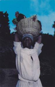 Woman carrying basketful of roosters for sale, Haiti, West Indies, 40-60s