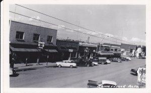 Postcard RPPC BONNYVILLE Alberta Canada Main Street Coca-Cola Dime Store Old Car