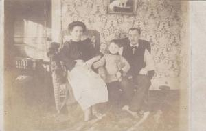 RP, Parents & Their Child with teddy Bear , Sitting Down Inside Their Warm Ho...