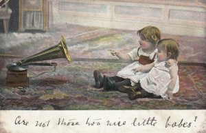 Toddlers looking at their reflection from phonograph, PU-1905