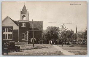 Gladbrook Iowa~Parishoners at Methodist Church~1920s Cars Line Street~RPPC