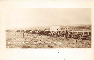 F36/ Saratoga Wyoming Postcard RPPC c1930s Bull Train Wagons