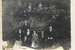 Family Photo @ Cliff~RPPC~Most Kids on Hill~Parents Below~Kid on Crutches~c1914