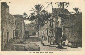 Algeria postcard Biskra ethnic types and scenes old street view