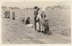 RP: HOLLAND , Michigan , 1931; Greetings, Family looking out at water from pier