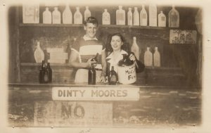RP: Couple in photo studio Dinty Moores bar prop , 1940-50s