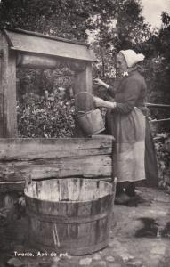RP; TWENTE, Aan de put, Overjssel, Netherlands, PU-1956; Old woman pulling water