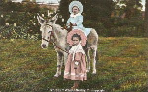 Little children with donkey. Whoa! Neddy Old vintage English postcard