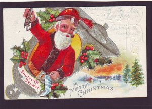 P1557 old used postcard embossed santa with pipe bell etc brothers delight