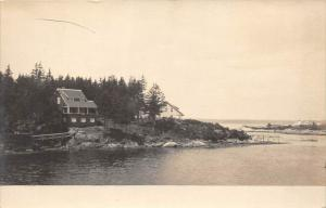 13053    Houses  on Island 1920's   somewhere in New England  real photo