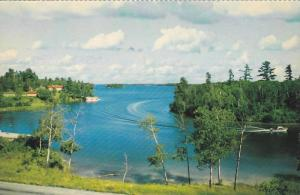 Speed Boat Cuts Through the Deep Blue Waters of Regina Bay, Lake of the Woods...