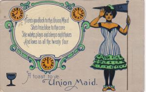 A toast to ye Union Maid Woman saluting wearing fitted strioed dress with 3...
