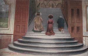Three people kneeling on the Grand Staircase, 00-10s