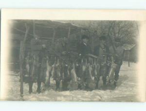 rppc Pre-1918 Hunting HUNTER MEN WITH RIFLE GUNS HOLD UP DEAD RABBITS AC7767