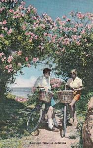 Young Couple Bicycling During Oleander Time In Bermuda