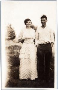 RPPC Portrait of Man and Woman - couple standing outside and smiling AZO 1904-19