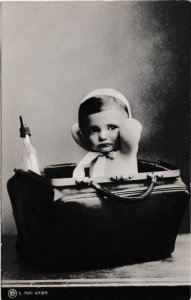 Postcard People Baby in a Bag with bottle 1907