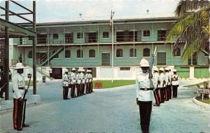 NASSAU BAHAMAS CHANGING OF THE GUARD~POLICE BARRACKS~EAST STREET POSTCARD c1966