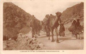 Lot142 real photo pakisan a caravan on way to peshawar from afganistan camel