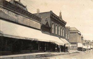 Toulon IL Swank Bldg~Derby Barber Shop~Grocer Stonier~Model Bakery~RPPC c1907