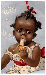 Black Little Girl eating Banana